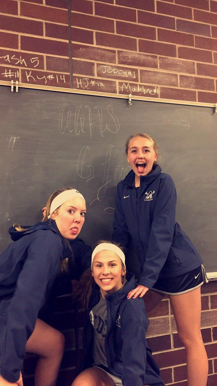 """Lax girls Jessica, Reagan, and Avery have a """"chalk talk."""""""