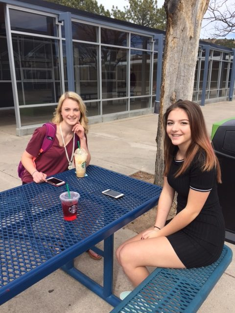 Freshmen Enjoy their Starbucks in the Courtyard