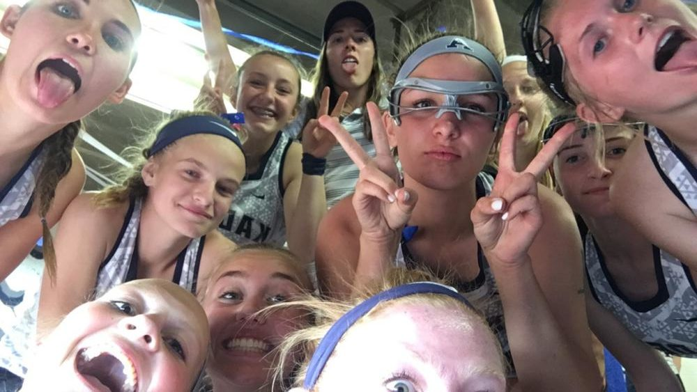 Lady laxers celebrate a league championship win