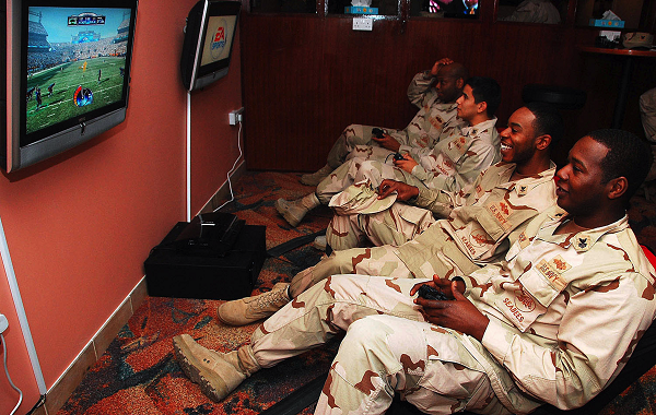 Members of the military enjoy video games. Photo via Wikimedia Commons under the Creative Commons license. http://commons.wikimedia.org/wiki/File:US_Navy_090205-N-7862M-002_Sailors_play_video_games_at_the_newly-renovated_Liberty_Center_at_Naval_Suppor t_Activity_Bahrain.jpg.