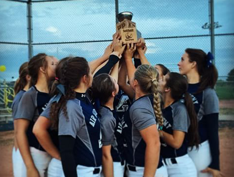 The softball team holds up their trophy after winning their conference.  Photo used with permission from Peyton Romines.