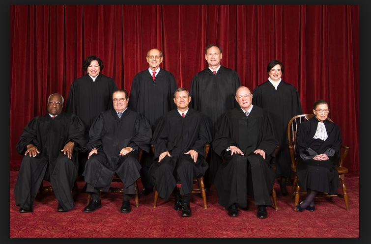 The SCOTUS before the death of Antonin Scalia. Photo used with permission from Wikimedia under the Creative Commons license. { https://en.wikipedia.org/wiki/List_of_Justices_of_the_Supreme_Court_of_the_United_States }