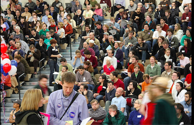 Many caucuses are held at high schools. Photo via Wikimedia Commons under the Creative Commons license. { https://en.wikipedia.org/wiki/United_States_presidential_election_in_Washington_(state),_2008#/media/File:43rd_Legislative_District_Democratic_Caucus_1.jpg }