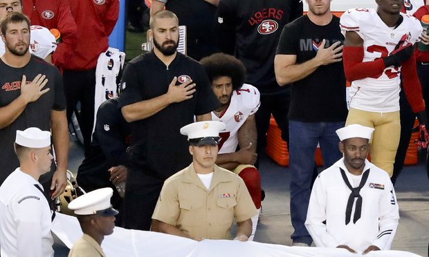 Photo+of+Colin+Kaepernick+kneeling+via+http%3A%2F%2Fwww.sacbee.com%2Fsports%2Fnfl%2Fsan-francisco-49ers%2F58d2ud-Colin-Kaepernick-kneels-during-the-National-Anthem-in-final-49ers-preseason-football-game%2FALTERNATES%2FLANDSCAPE_1140%2FColin%2520Kaepernick%2520kneels%2520during%2520the%2520National%2520Anthem%2520in%2520final%252049ers%2520preseason%2520football%2520game+under+labeled+for+reuse