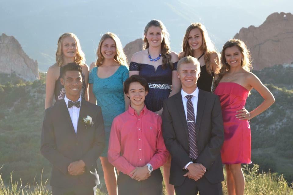 A group of seniors take pictures for Homecoming.