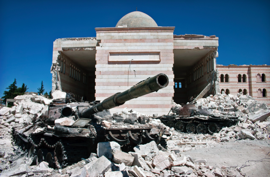 A photo shot in the ruble of a building damaged from Syrian Civil War. Photo via Wikipedia under the Creative Commons License. https://en.wikipedia.org/wiki/Syrian_civil_war