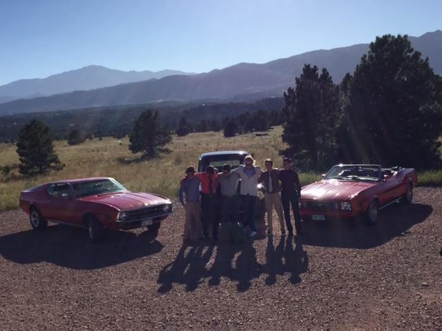 Home Coming pictures in front of the Rocky Mountains and some classic cars.