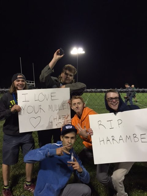 Kadets at the Woodland Park Football game cheer for players on both teams.