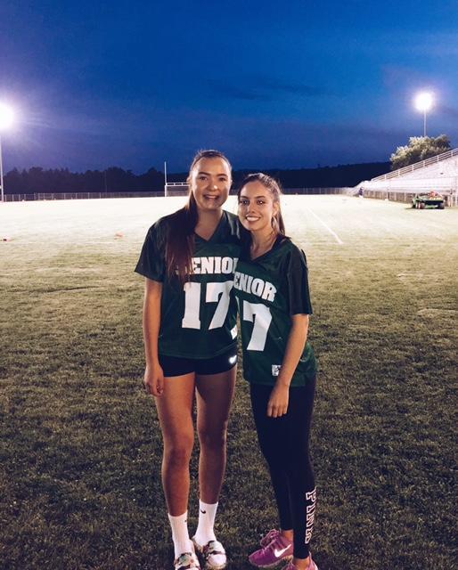 Students Elena Saulo and Helen Khoshroshali posing after the powderpuff football game