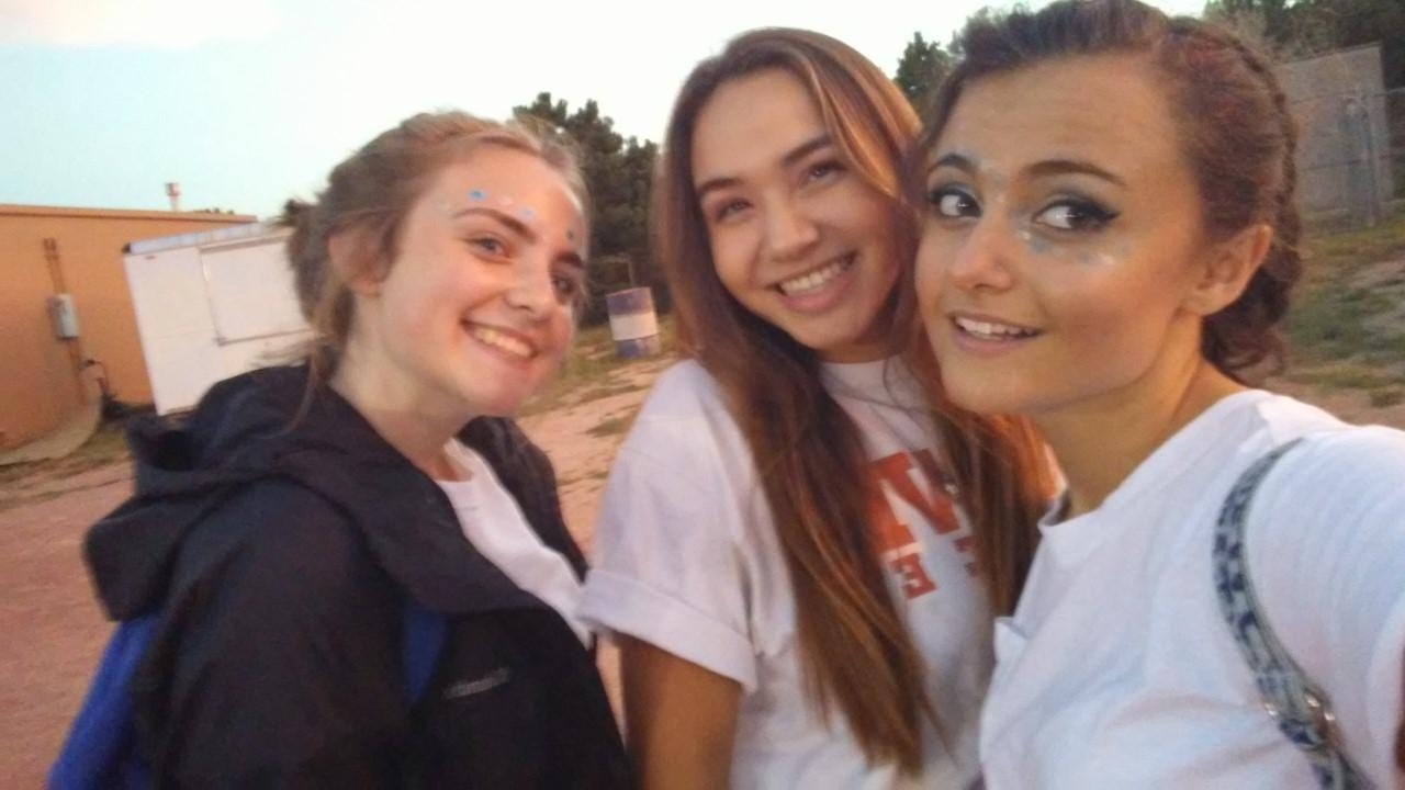 Juniors hanging out at a football game