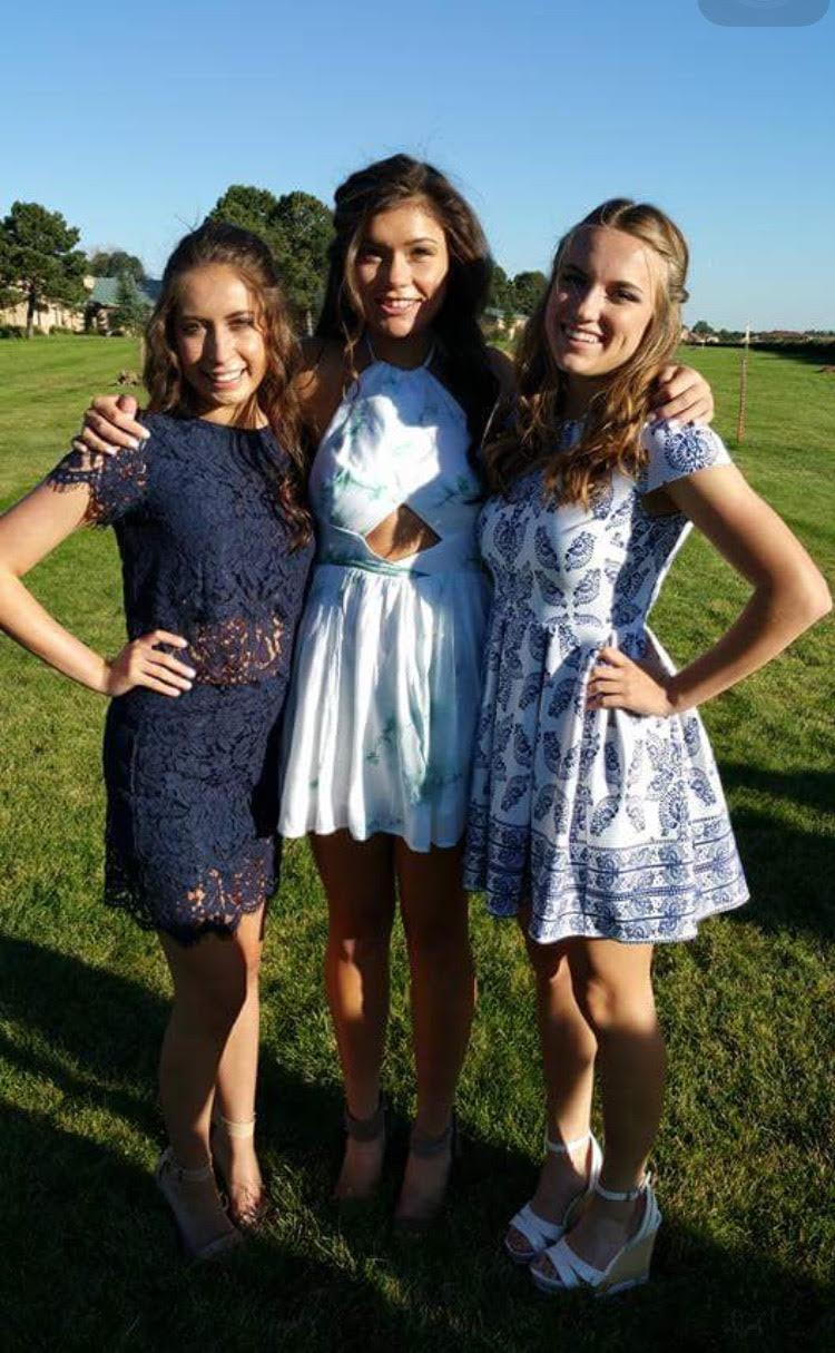 Erin Lindsey, Kennedy Jamieson, and Natalie Sannes at homecoming