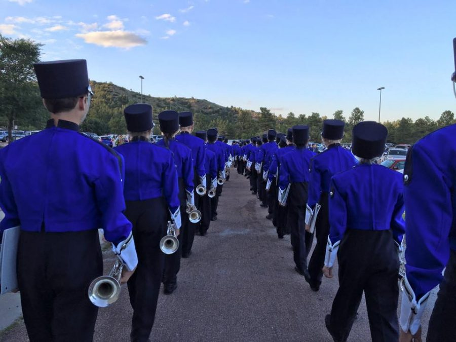 This years trumpet section on their way to the homecoming game.  Photo used with permission from Air Academy Band