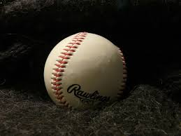 Photo via Wikimedia Commons under The Creative Commons Lisence. https://commons.wikimedia.org/wiki/File:Baseball_on_black_cloth.jpg