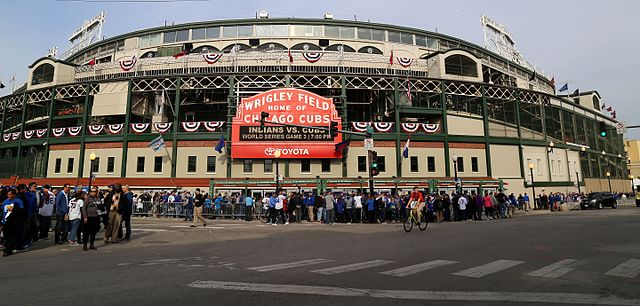 Wrigley Field in Chicago during Game 3 of the 2016 World Series. Used under the Creative Commons License via Wikimedia Commons. https://en.wikipedia.org/wiki/Chicago_Cubs#/media/File:Fans_descend_on_Wrigley_Field_for_World_Series_Game_3._(30642800165).jpg