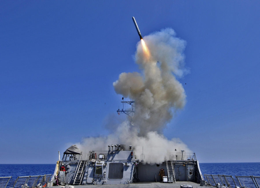 USS Barry fires a Tomahawk missile. Labeled for reuse under Flickr Commons.