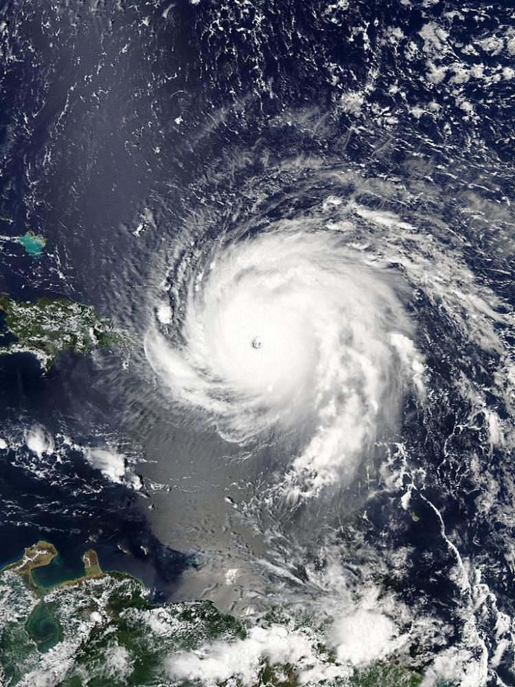 An+aerial+view+of+Hurricane+Irma+at+its+peak+strength+over+the+Virgin+Islands.+Image+taken+by+NASA+and+used+under+the+Public+Domain.+Photo+via+Wikimedia+Commons+under+the+Creative+Commons+License.+https%3A%2F%2Fcommons.wikimedia.org%2Fwiki%2FFile%3AHurricane_daniel_2006.jpg