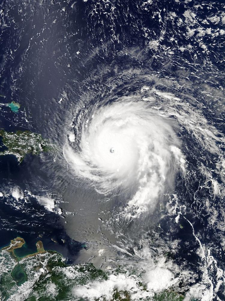 An aerial view of Hurricane Irma at its peak strength over the Virgin Islands. Image taken by NASA and used under the Public Domain. Photo via Wikimedia Commons under the Creative Commons License. https://commons.wikimedia.org/wiki/File:Hurricane_daniel_2006.jpg