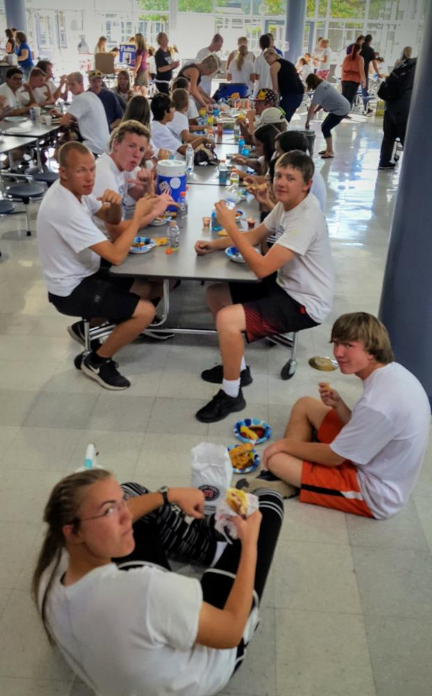 Air Academy band students enjoy a dinner together.