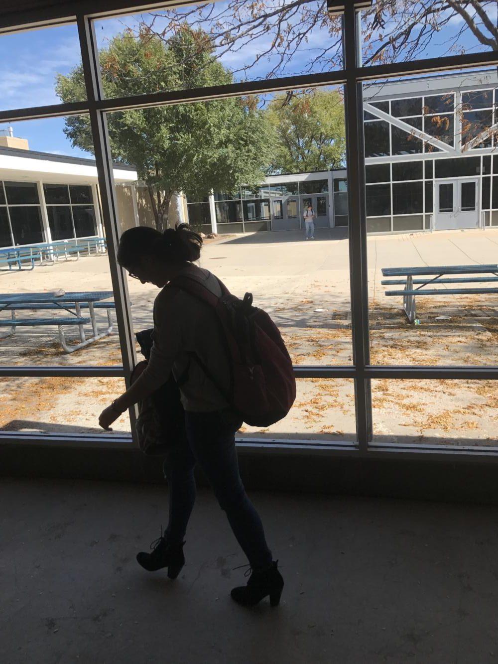 Meili Finkle walking in a hallway