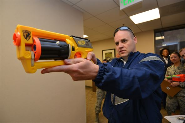 Man holds Nerf gun, photo courtesy of  http://www.afspc.af.mil/News/Article-Display/Article/730997/50-sw-chapel-presents-amazing-grace/