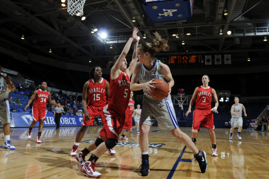 Used under the creative commons law (http://www.af.mil/News/Article-Display/Article/118195/womens-basketball-bradley-defeats-air-force-62-45/)  Falcons freshman forward Katie Hilbig pushes toward the basket as the Braves Hanna Muegge defends during the Air Force-Bradley game at the Air Force Academys Clune Arena Dec. 19, 2009. Hilbig, a native of Castle Rock, Colo., had two rebounds in the Falcons 62-45 loss. (U.S. Air Force photo/J. Rachel Spencer)