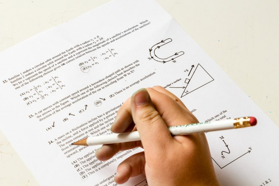 Picture of student doing homework labeled for reuse from Pixabay.com