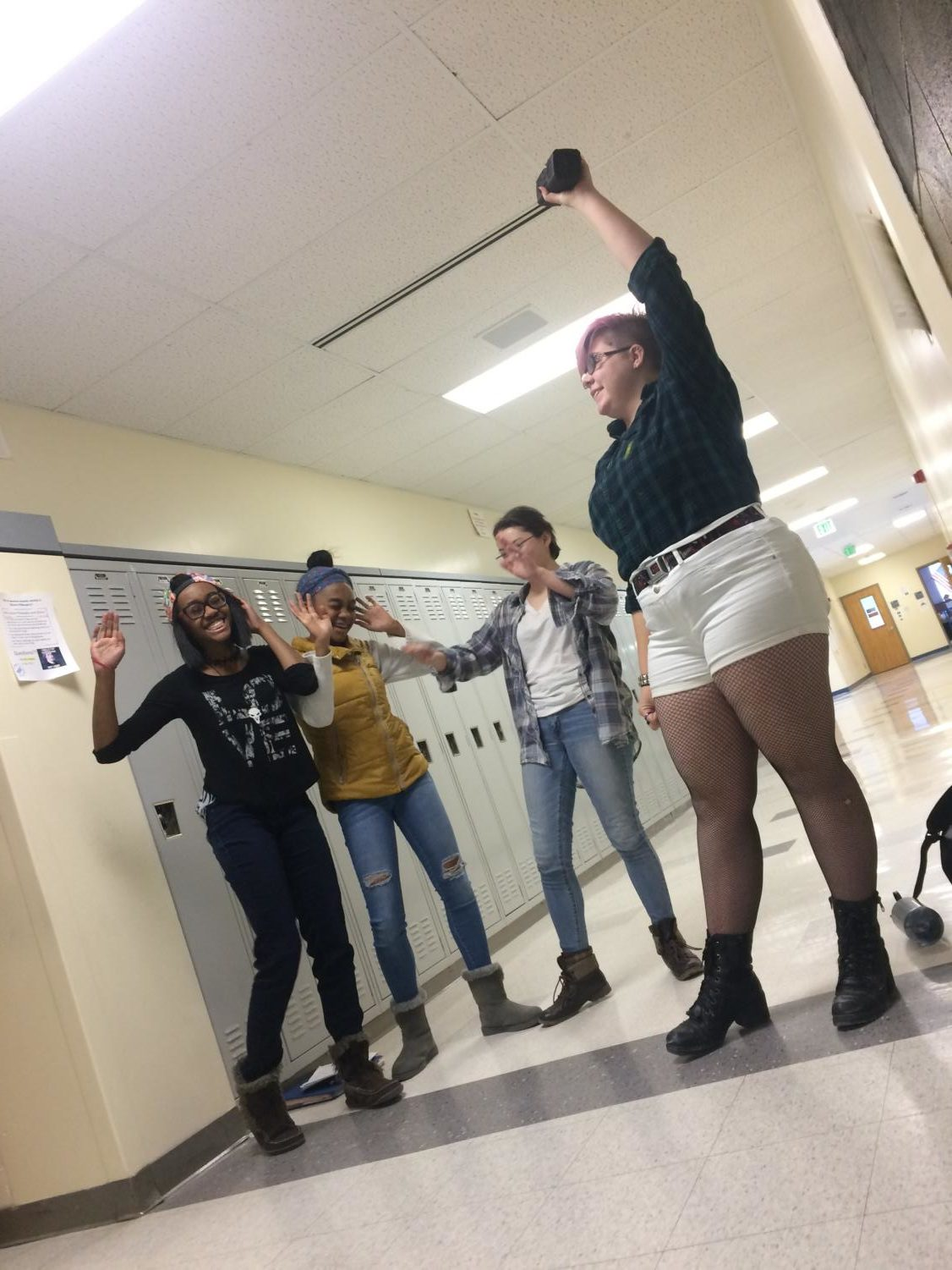 Students rock out to blaring music in D building.  Left to right: Kamiyah Corinaldi, Kaley Corinaldi, Jayci Richardson, Skye Cook.
