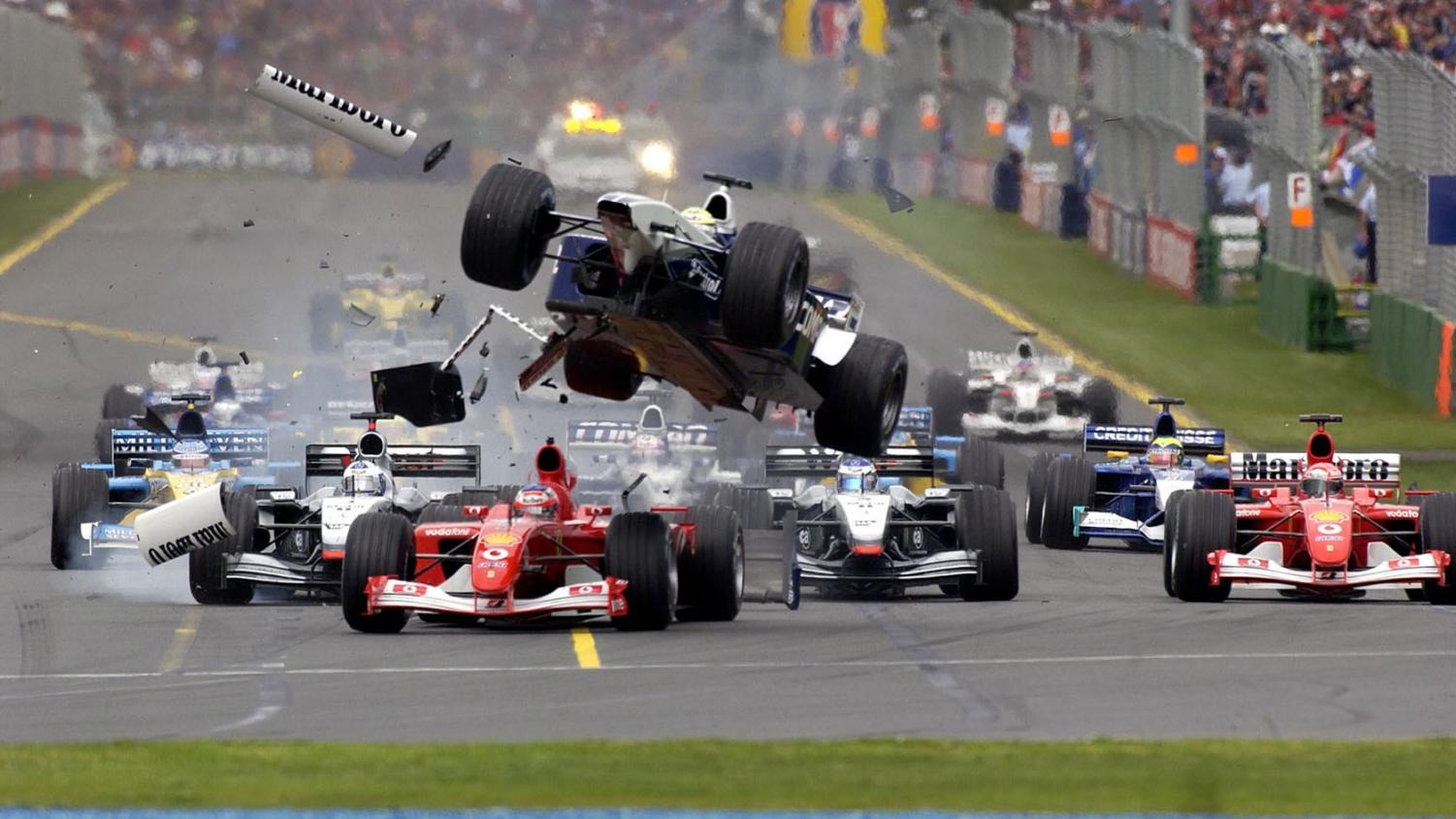 Ralf Schumacher takes flight in his Formula 1 car at the 2002 Australian Grand Prix in Melbourne. Labled for reuse by FIA and Formula 1