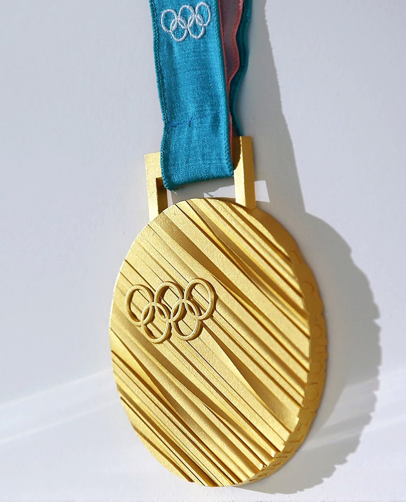 Gold medal from the 2018 Winter Olympics in Pyeongchang. Labeled for reuse under Wikimedia Commons.