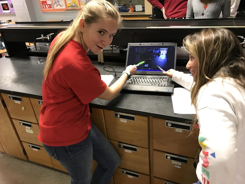 Kali Brigham and Paula Giraldo working on their physics lab.