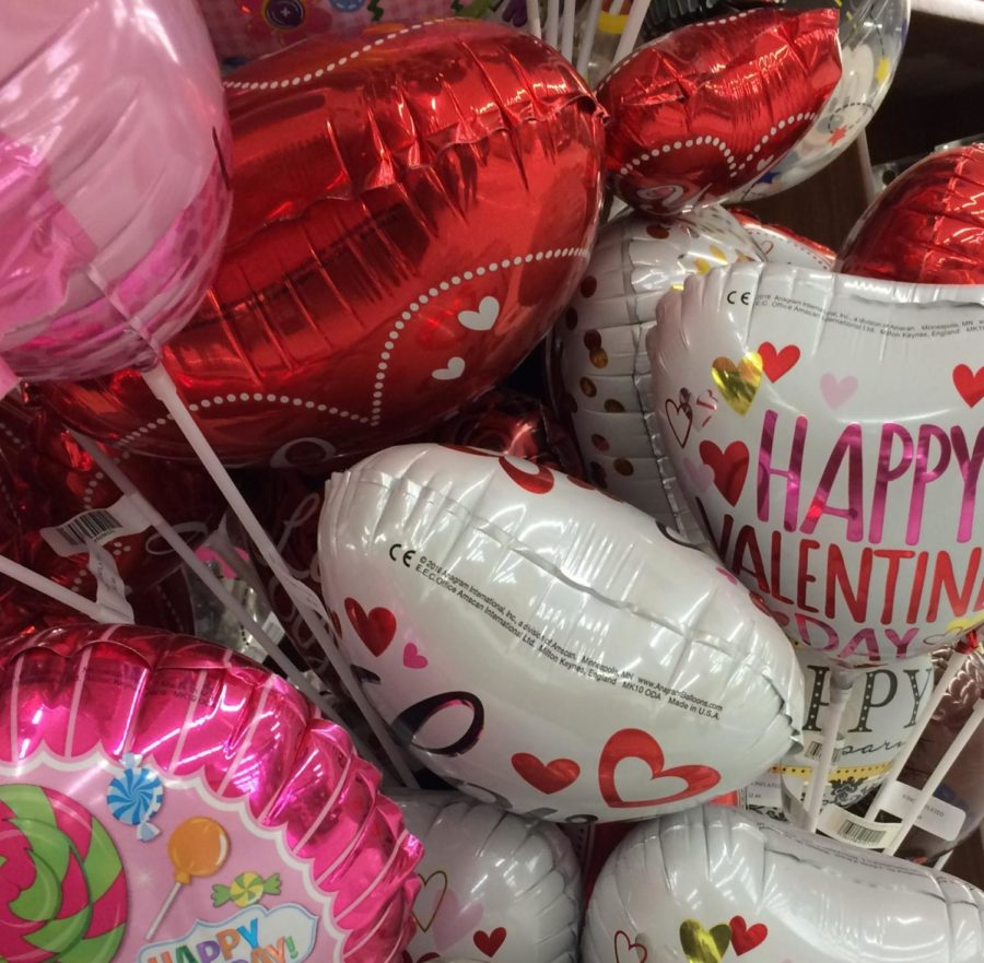 Heart balloons on sticks: crowded and on sale at local grocery store.