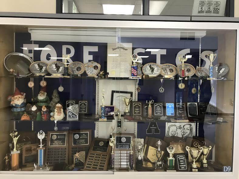 The Forensics Speech and Debate team's trophy case is overflowing!