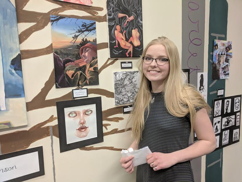 Molly Robinson with her artwork that won 2nd place in The Jetstream Journal Art Contest.