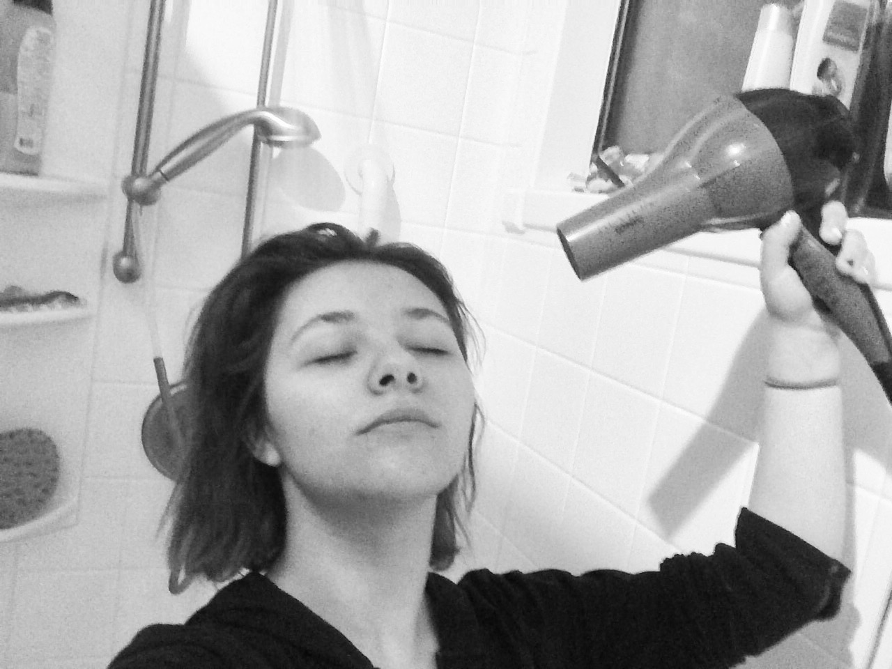 Idiot holds blow dryer in the shower.
