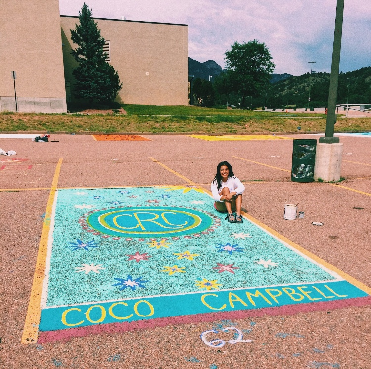 Senior Cori Campbell after painting her parking spot in the senior parking lot.
