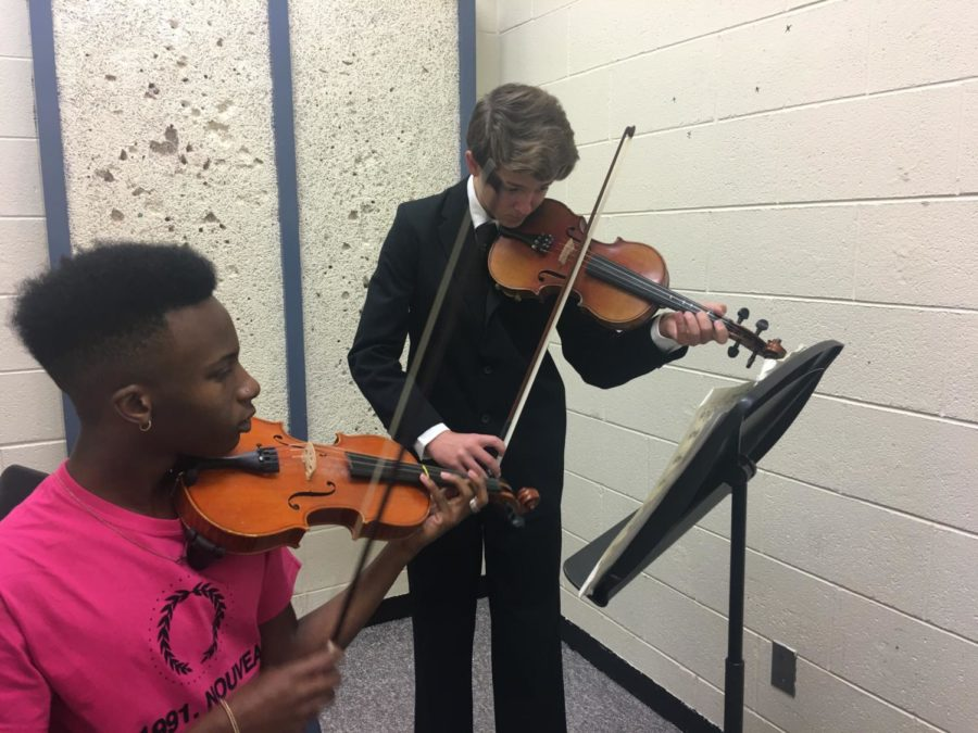 Senior Jordan Hubbard (left) and freshman Logan Fairhurst (right) practicing their Solo and Ensemble music piece.