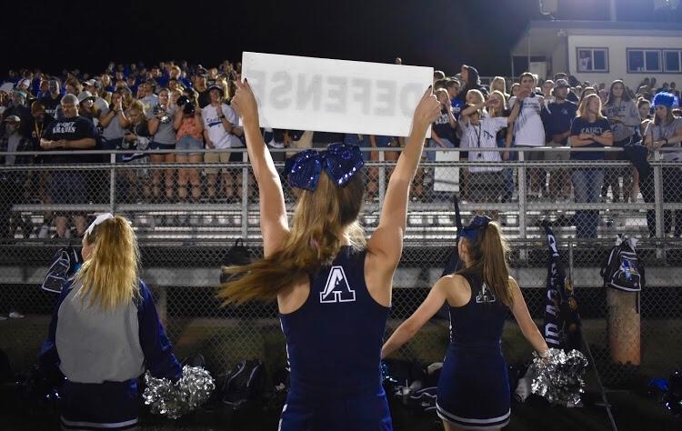 AAHS cheerleaders performing at a football game.