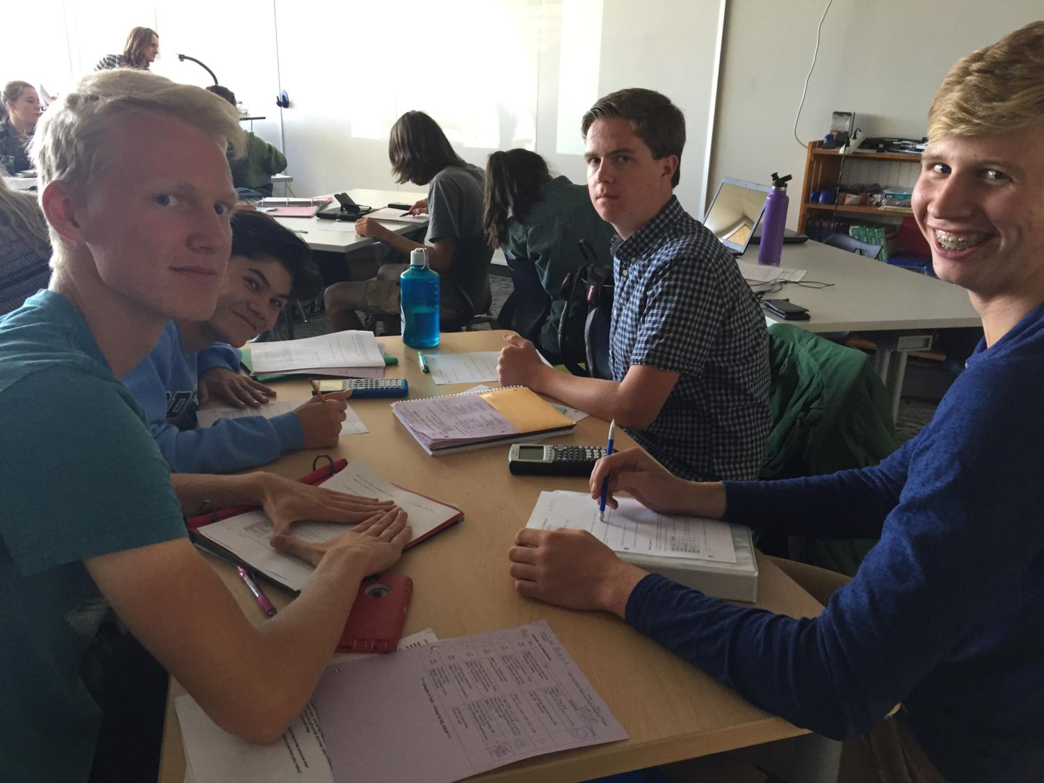 Seniors Luke Britsch, Andrew Tassler, Josiah Bathje, and Peter Lark enjoy another fun-filled class in AP Statistics.