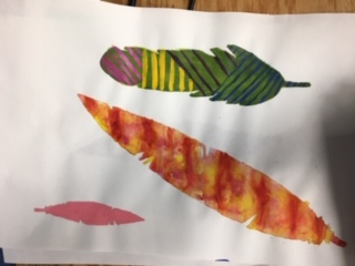 Students paint feathers in Art Club.