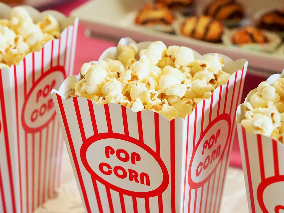 """Popcorn at the movies is a classic treat.  Photo courtesy of Dbreen. """"Popcorn, Movies, Cinema"""