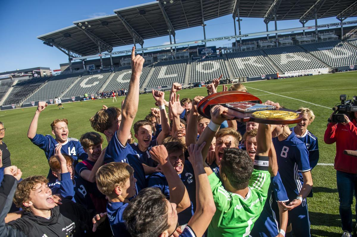 Boy's Soccer team raises up State Championship after winning an incredible game.