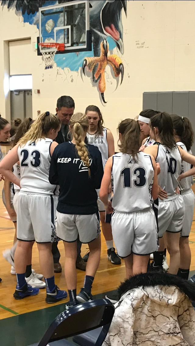The 2017-2018 Girls Junior Varsity team huddles up in preparation for the second half of the championship game.