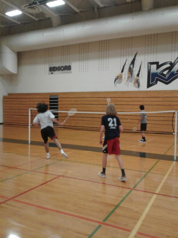 Connor+Dalrymple%2C+Jake+Stinson%2C+Allison+Raulie%2C+and+Chase+Giglio+play+an+intense+game+of+badminton.