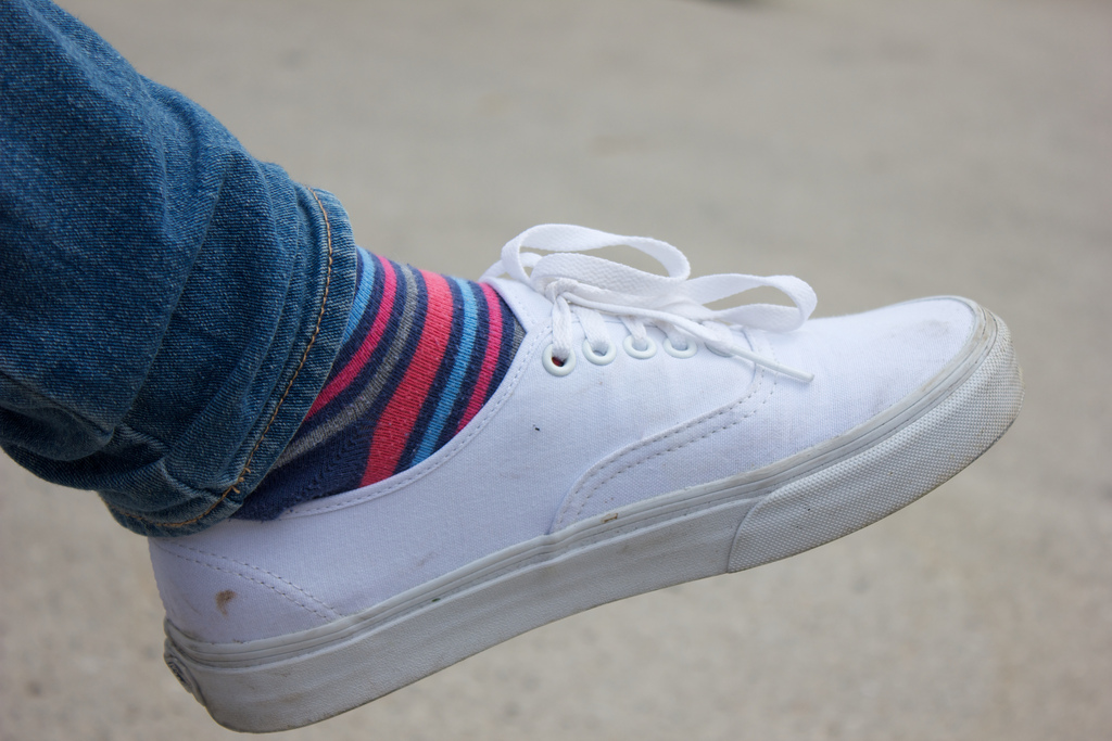 AAHS junior shows off his white vans and colored socks.