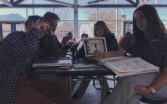 Photo originally published in the Jetstream in 2018. Juniors Maizie Daye and Kate Farhart start finals' studying during the S4 study hall.