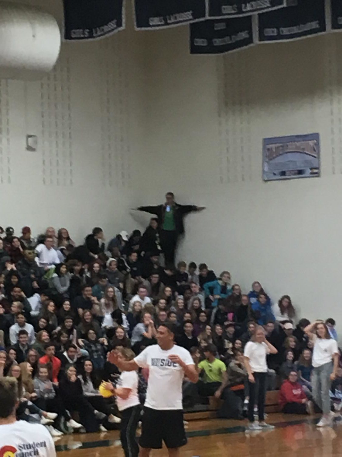 Sophomore T-poses at student-teacher dodgeball match.