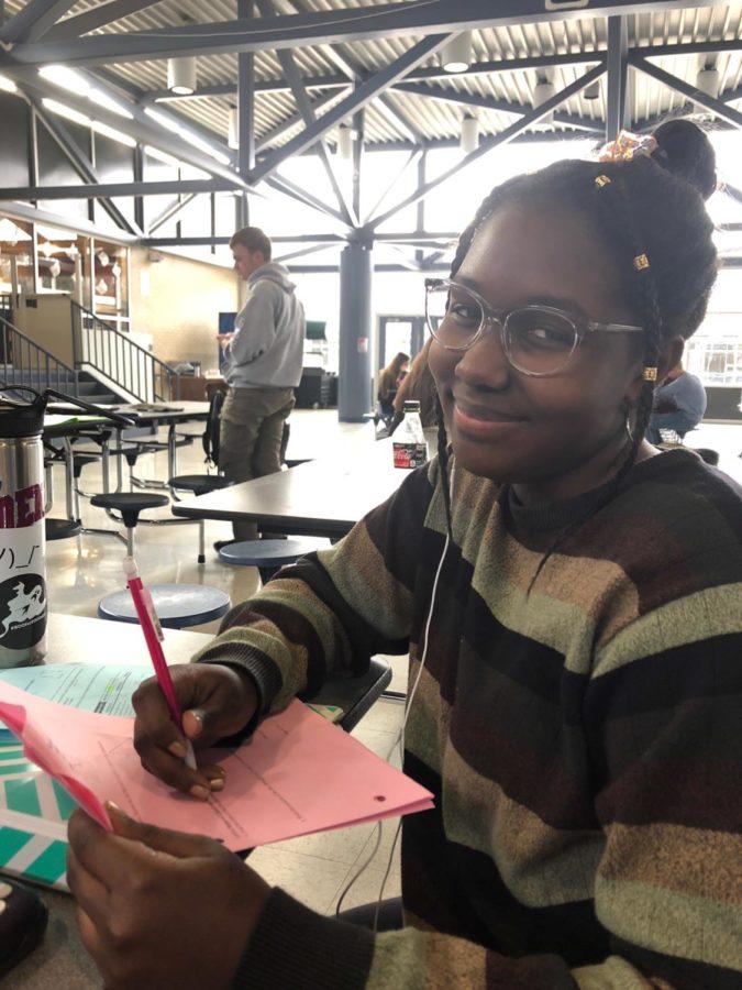 Sophomore Ashlyn Johnson works hard on geometry homework. She uses her study hall for class work.