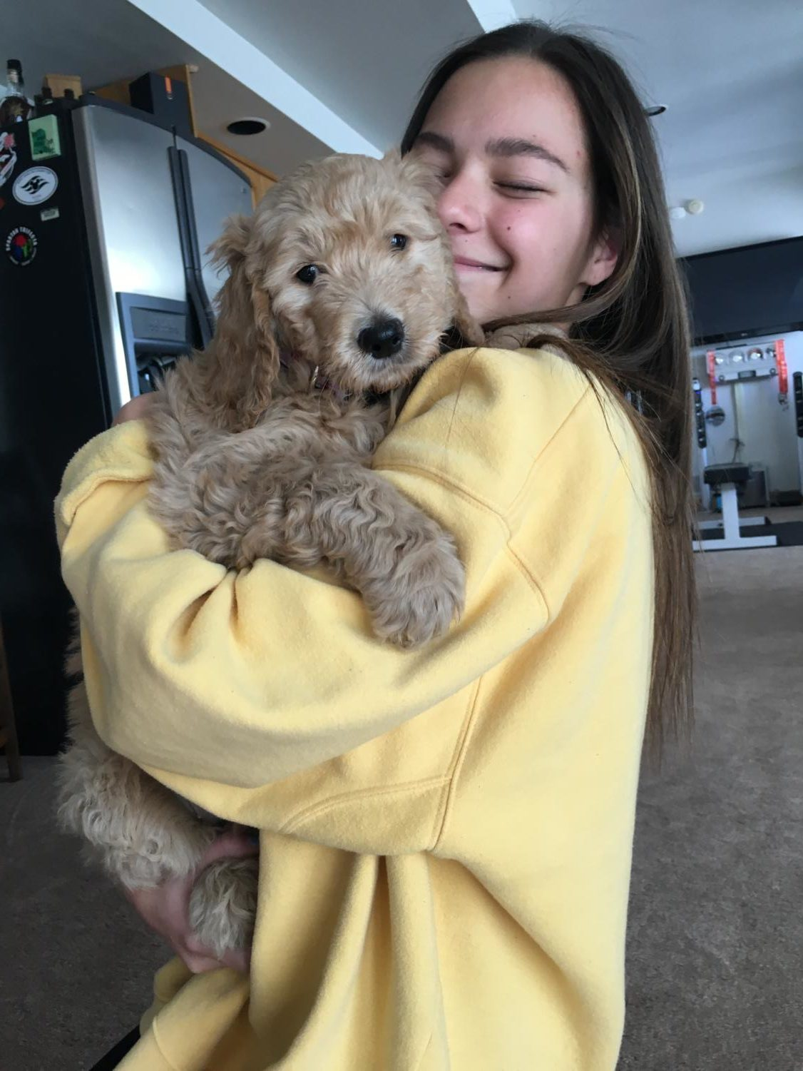 Junior Audrey Sandell gives her brand new golden-doodle puppy hugs for the holidays.