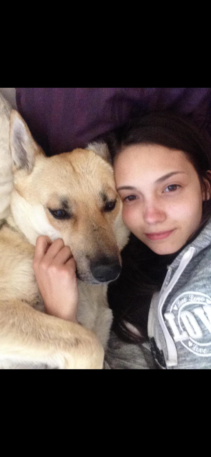 Sophomore Alana Escalante, who works with the MAMCO Rescue, cuddles with her foster dog.