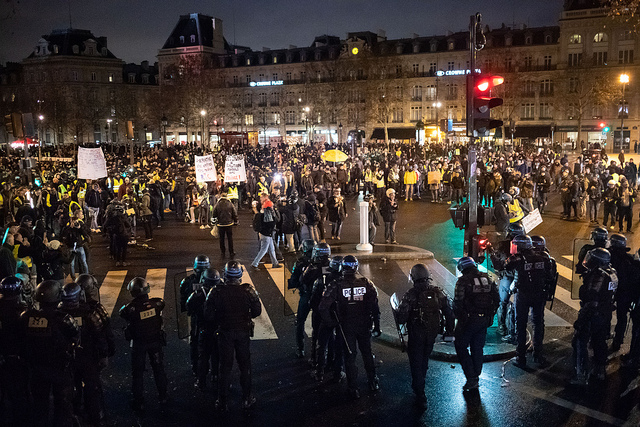 Taken+on+1%2F26%2F19+-+the+11th+weekend+of+the+riots+in+France.+The+%22Yellow+Vests%22+gather+at+the+place+de+la+R%C3%A9publique+to+protest.+Labeled+for+reuse+by+Flickr%2C+credit+goes+to+Olivier+Ortelpa.+His+%22Paris%2C+Gilets+Jaunes%22+photo+album%3A+https%3A%2F%2Fwww.flickr.com%2Fphotos%2Fcopivolta%2Falbums%2F72157704690227961